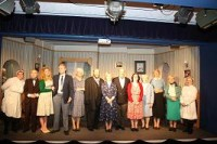 Left to right: Doreen (Catherine Langley), Mr. Fowler (Richard Britnell), Miss Tanner (Amanda Chapman), Mr. Stratton (Jack Macauley), Mrs. Railton-Bell (Jennifer Gill), Major Pollock (Paul Monoghan), Sybil Railton-Bell (Louisa Robinson), Miss Cooper (Judy McKinnel), Lady Matheson (Janiece Spence), Miss Meacham (Liz Cooke), Mabel (Marion Clapham)