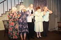 Unfortunately, one murder isn't enough. To protect the identity of the killer, the ladies cover their eyes whilst the murderer poisons another cup of tea. Left to right: Miss Birdie (Judy McKinnell), Miss Lucy (Charlotte Bond), Miss Amantha (Janiece Spence), Miss Nettie (Theresa Mulkerin) and Miss Hildegarde (Helen Harries).