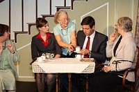 A tense moment when Dennis O'Finn (Michael Luke), tries to drink the tea meant for nosy reporter Jane (Jayne Stopford-Taylor). Miss Hildegarde (Helen Harries) steps in to avoid confusion.