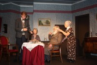 Abby (Teresa Hagger) and Martha (Helen Harries) attempt to poison Mr. Gibbs (Zam Tee) in front of a horrifed Mortimer (Henry Cockburn)
