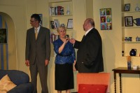 Florence (Liz Cooke) shows burnt dinner to Jesus (Colin Clark) and Manola (Neil Gander)