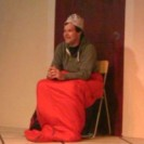 Kevin sitting on his chair in his sleeping bag