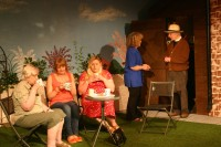 An awkard moment as Jo (Caroline Chapman), Sarah (Kayleigh Knox) and Ruth (Kate Lawrie) pretend not to notice Grace (Helen Harries) having a conversation with her late husband (John McKinnel)