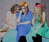 Left to right: Heather Prestwich as Teresa, Samantha Craig as Catherine, Jayne Stopford-Taylor as Mary, all laughing as they try on their mother's clothes